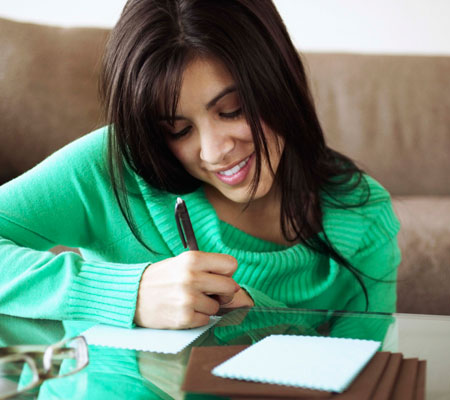woman-writing-note-photo-450x400-ts-86530063